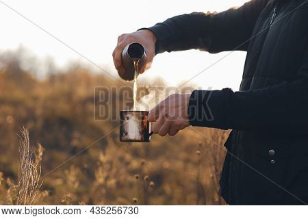 Autumn.Autumn concept.Hot coffee in hand.A mug of hot chocolate in the hands in the fall.Hot coffee