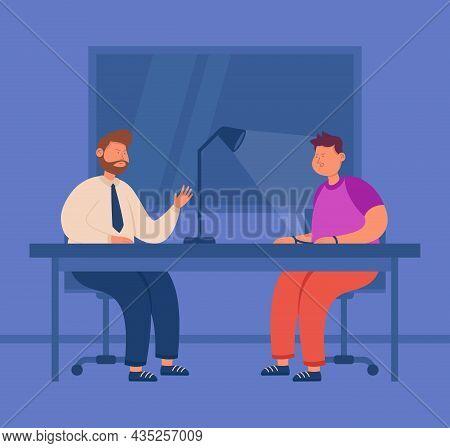 Police Investigator Interrogating Criminal In Interrogation Room. Suspect And Officer Sitting At Tab