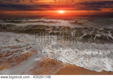 Sunset landscape over stormy sea