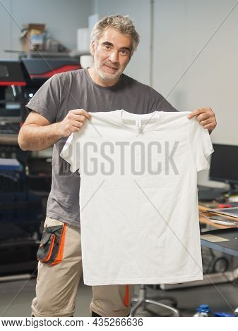 Technician Showing Empty T-shirt With Blank Space For Insert Print