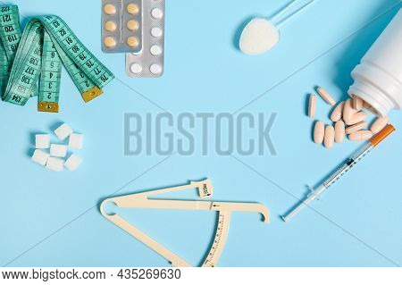 World Diabetes Awareness Day. Flat Lay. White Refined Sugar, Caliper, Measuring Tape, Scattered Pill