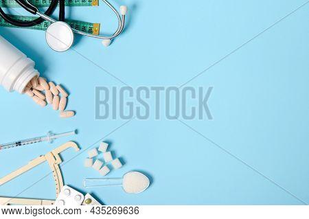 Scattered Pharmaceutical Pills, Blisters Of Tablets, Insulin Syringe, Stethoscope, Caliper, Measurin