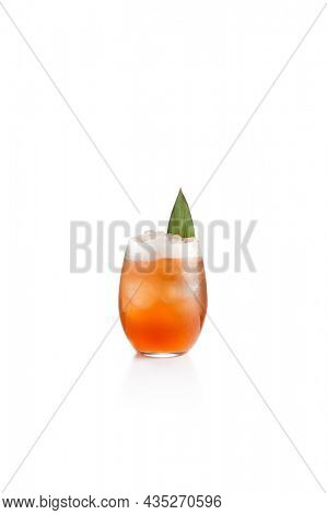 Traditional Italian alcoholic cocktail - aperol spritz on white background. Aperol spritz in wine glass. Alcohol drink with liquor aperol, prosecco and citrus. Orange cocktail with sparkling wine