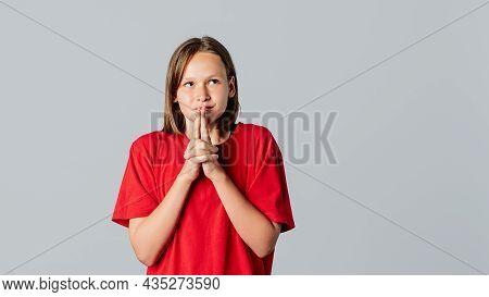 Beautiful Brunette Teen Girl Anticipating Something Wonderful, Making Wish, Wear In Casual Red T Shi