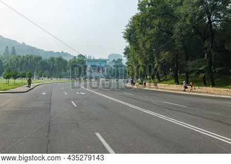 Pyongyang, North Korea - July 28, 2014: An Empty Road On A Street In Pyongyang. A Panel Depicting No