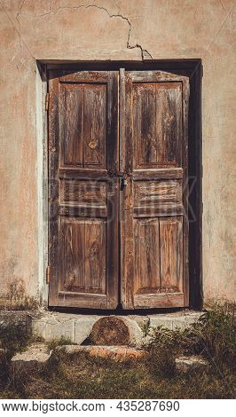 Old Shabby Faded Wooden Doors In An Abandoned House