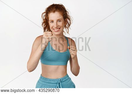 Smiling Fitness Girl Practice Martial Arts, Clench Fists And Fighting. Sportswoman Doing Boxing Work