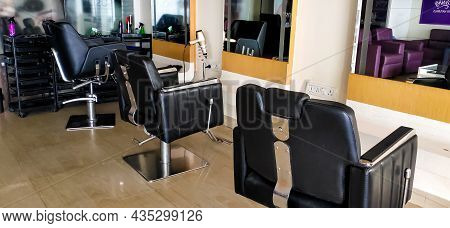 Interior Of An Empty Barber Shop Or Parlour With Modern Equipments , Chairs And Lights. Men\'s Groom
