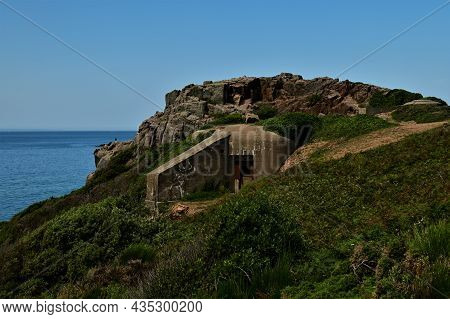An External View Of A German World War Two Military Bunker At Petit Port On The Scenic Coast Of Jers