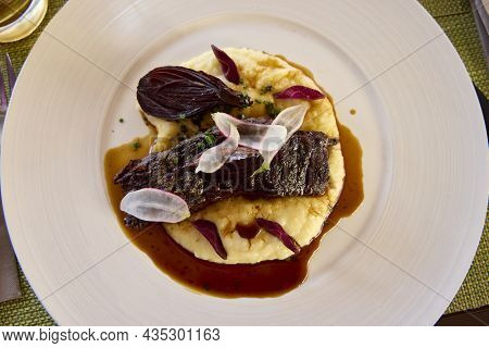 Plate Of Beef Tenderloin With Mashed Potatoes