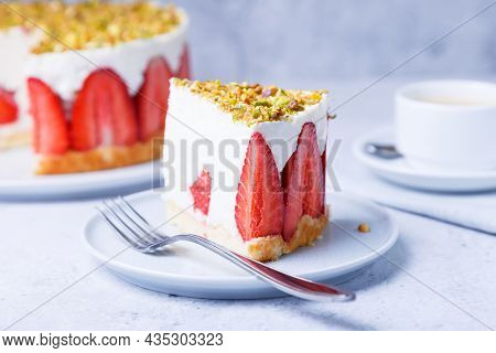 Freesier Cake With Fresh Strawberries And Pistachios. French Classic Dessert. Portion Of Cake On A W