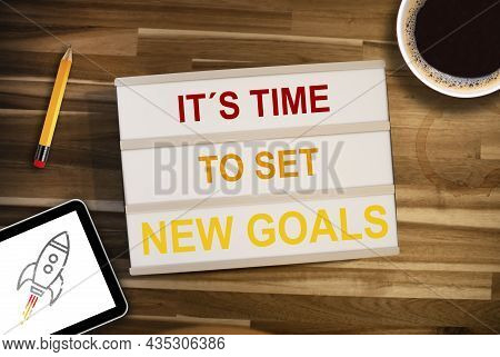 Lightbox Or Light Box With Business Message Time To Set New Goals On A Wooden Table With Coffee, Pen