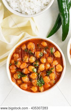 Indian Style Cooked Chickpeas In Bowl Over White Background. Vegetarian Vegan Food Concept. Top View