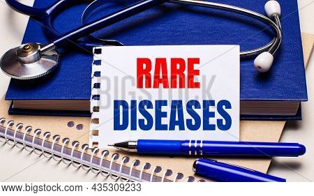 On The Table Are Notepads, A Stethoscope, A Pen And A Sheet Of Paper With The Text Rare Diseases. Me