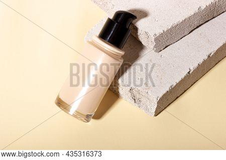 Foundation, Concealer On A Background Of Concrete Geometric Shapes. Face Corrector On Beige Backgrou