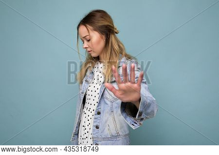 Photo Of Young Sad Upset Attractive Blonde Woman With Sincere Emotions Wearing Jean Blue Jacket Isol