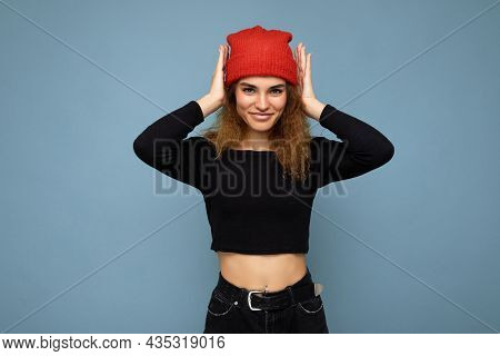 Shot Of Young Nice Winsome Brunet Woman Wavy-haired With Sincere Emotions Wearing Black Crop Top And
