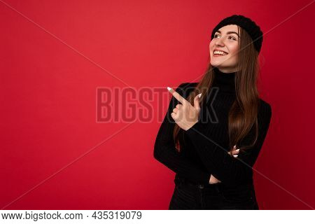 Charming Fascinating Emotional Positive Joyful Happpy Female Promoter Pointing To The Side At Copy S