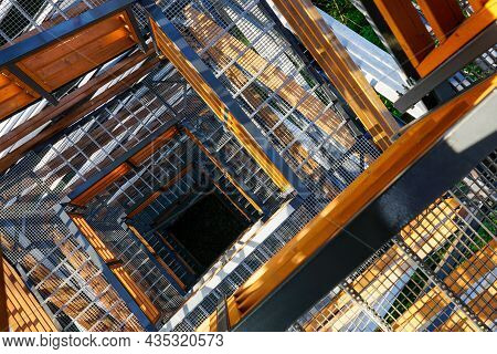 A Fragment Of The Structure Of A New Modern Metal Observation Tower With Decorative Wooden Elements