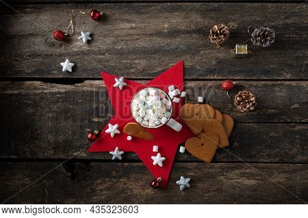 Top View Of Cup Of Hot Chocolate Heaping With Sweet Marshmallows Placed On A Red Holiday Star With C