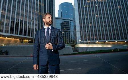 Charismatic Businessperson In Businesslike Suit Outside The Office, Copy Space, Success