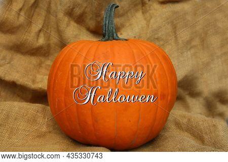 Pumpkin. Halloween. Thanksgiving. Pumpkin on a background of burlap. Halloween pumpkin. Thanksgiving Pumpkin. Happy Halloween Text.