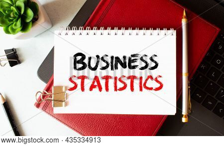 Text Business Statistics On Easel With Office Tools And Paper.top View.
