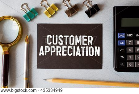 Customer Appreciation Text Written On A Notebook With Pencils.