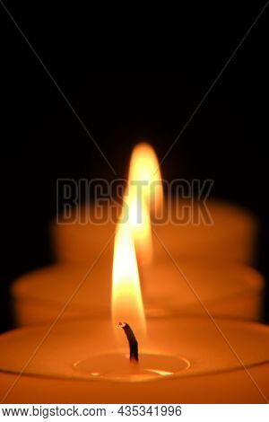 Candle Row On Black Background.candle Flame.candles Background. Burning Candles In The Dark.close-up