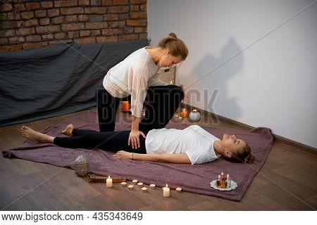 Relax And Enjoy In Spa Salon Getting Thai Massage By Professional Masseur Woman Lying Floor Blanket