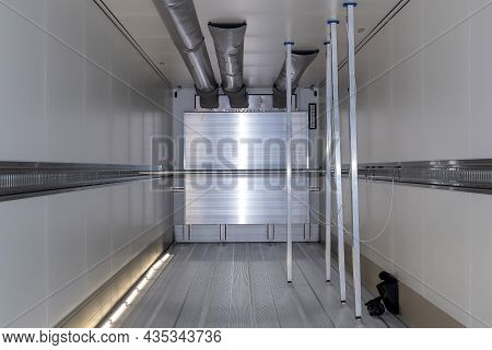 Empty Refrigerated Truck Inside, With Cargo Area Lighting. Interior Of Van For Transporting Frozen F