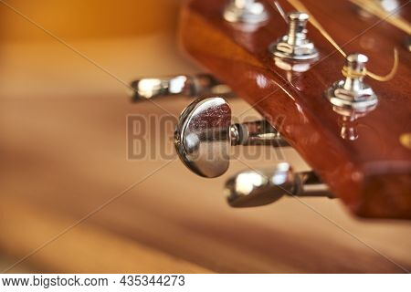 Acoustic Guitar Pins. Close-up Horizontal Image With Wood Background And Selective Focus.