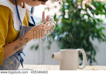 Recreation After Work With Pottery Handmade Courses: Closeup Of Young Hipster Woman Concentrated On