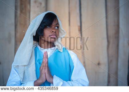 Black Virgin Mary Representation Praying In A Crib