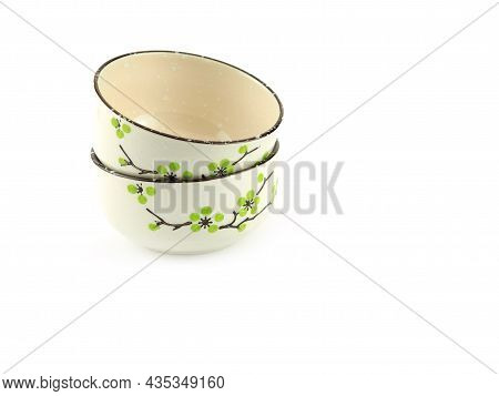 Empty Stack Beige Ceramic Bowl With Brown Rim And Green Flora Pattern Isolated On A White Background