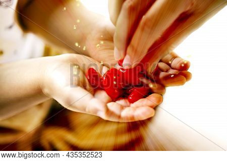 Adult And Little Child Holding Red Hearts, Close Up Isolated And Energy With Sparkle On White Backgr