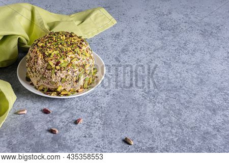 Halva With Pistachios On Top, Few Scattered Nuts, Green Linen Napkin And Large Copy Space. Tradition