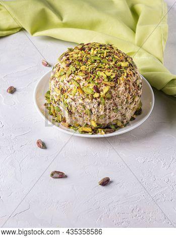 Sesame Halva With Pistachios On Top, Few Scattered Nuts, Green Linen Napkin. Turkish Delight. Tradit