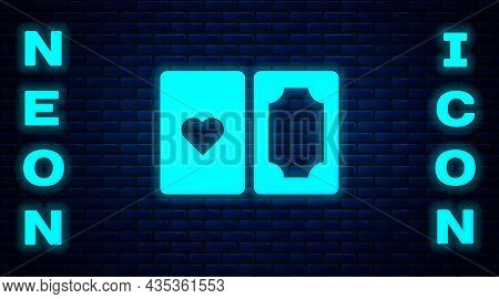 Glowing Neon Deck Of Playing Cards Icon Isolated On Brick Wall Background. Casino Gambling. Vector