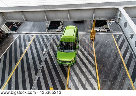 Los Cristianos, Spain - August 9, 2021: Vehicles Boarding The Ferry In Los Cristianos Harbour. Roro