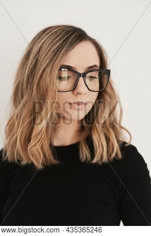Portrait Of A Young Blond Woman With Long Bob Haircut Wearing Eyeglasses With Black Frame. Eyewear.
