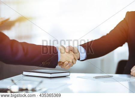 Business People Shaking Hands At Meeting Or Negotiation, Close-up. Group Of Unknown Businessmen In A