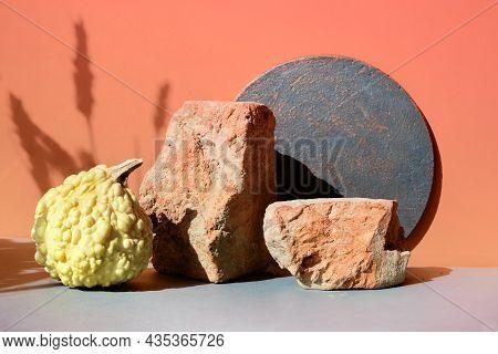 Modern Autumn Brick Podium In Orange And Grey With Natural Seasonal Fall Pumpkin. Natural Sunlight,