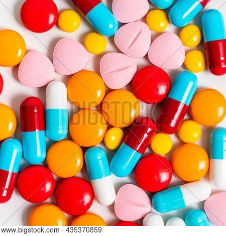 A Lot Of Pills Colorful On The White Background. Medicine Pills, Tablets And Capsules.