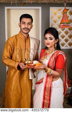 Portrait Of Indian Men Dressed In Kurta Pajama With Beautiful Indian Woman Wearing Traditional India