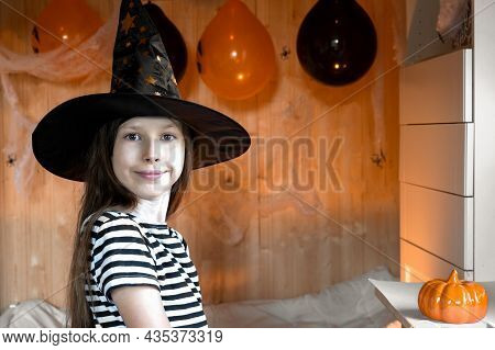 Portrait Of Adorable Teen Girl Wearing Halloween Hat, Dancing And Smiling. Halloween Home Family Par