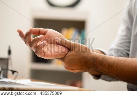 Close Up Male Hand Get Hurt And Pain In Hand, Wrist. Symptom Office Syndrome. He Has Symptom Stress
