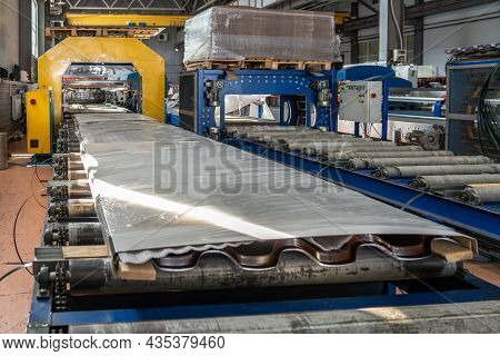 Conveyor With Finished Packaged Products Of Metal Tile Sheets For Roof In Metalworking Factory Works