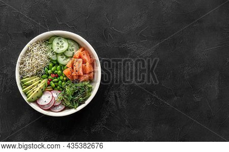 Keto Diet Poke Bowl With Salmon, Avocado, And Edamame Beans. Over Dark Background. Banner, Top View,
