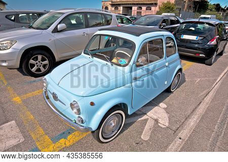Trieste, Italy, September 30 2021: Iconic Italian Car Fiat 500 In Turquoise Blue Color View. Small R